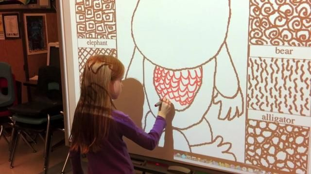 """1st Grade Artists Practiced """"Visual Texture"""" on our Interactive Whiteboard by Suzanne Tiedemann. Some 1st grade artists used our interactive whiteboard to practice making visual texture before actually drawing textures on their papers. Others practiced on worksheets at their tables."""