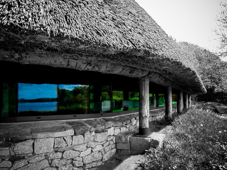 Lough Gur (Loch Gair) lake reflection in museum windows. #abstract #architecture #art #black and white #building #dried #effect #ethnographic #europe #glass #home #house #ireland #irish #lake #lough gur #museum #reed #reflection #romantic #roof #season #selected colors #stick #summer #tourism #traditional #travel #water #window