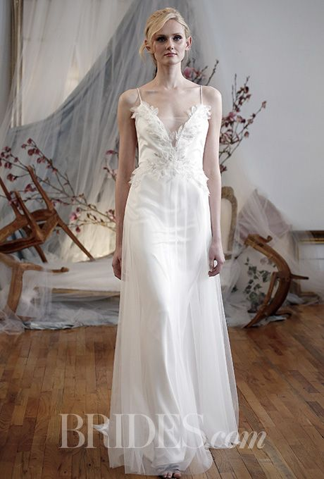 A sheath-style @efillmore wedding dress with flowery detailing | Brides.com