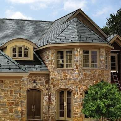 Slate Roof ~ Slate quarried for roofing is dense, sound rock, and is exceedingly tough and durable. While it is labor-intensive and costly to install, a natural slate look will give character to a building unlike any other roofing material.  Available in an array of colorations, slate roofing is non-combustible, waterproof, and requires little to no maintenance over the course of its long life. Cost: $600 - $1,500 per square installed.