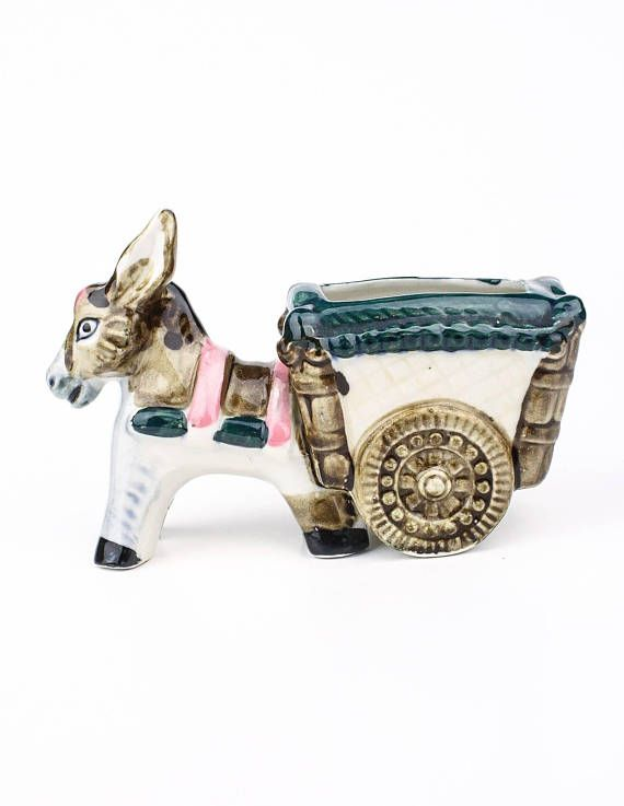 Mexican vintage ceramic planter in my #etsy shop https://www.etsy.com/ca/listing/581629049/70s-ceramic-donkey-pulling-cart-planter