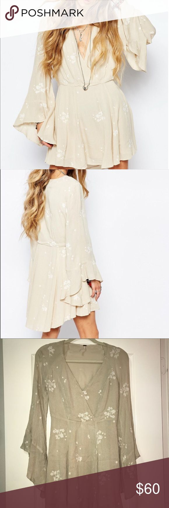 Free People Jasmine Mini Dress Never Worn. Almond combo Free People Jasmine Embroidered Mini Dress is an airy Mini Dress with a flared skirt. Ruffle cuffs and floral embroidery accentuate the romantic feel. Crossover V neckline. Long sleeves. Lined. Size 0.  Shell 100% Rayon Lining 65% rayon/35% cotton Free People Dresses Mini