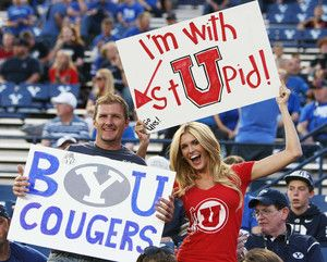 Devan and McKinli Hatch, Lindon, holds signs prior to the BYU Utah game during NCAA football in Provo Saturday, Sept. 21, 2013. (Jeffrey ...