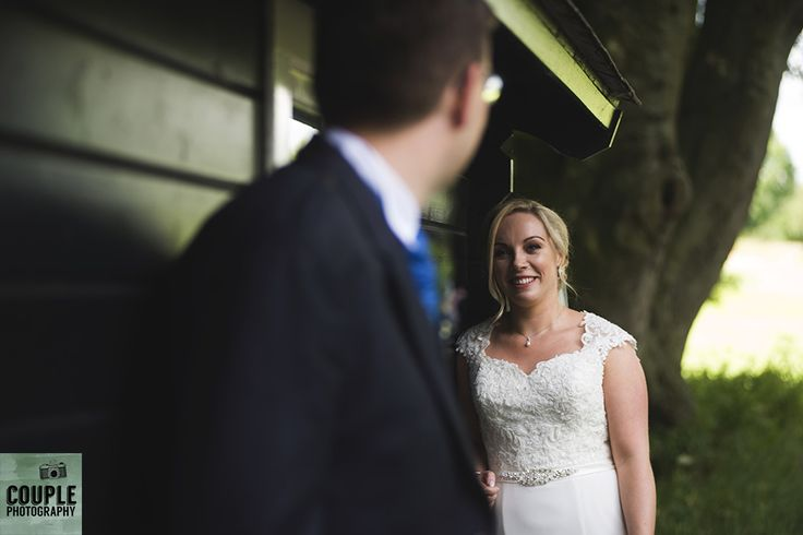The bride & groom by the golfers cabin. Weddings at Tulfarris Hotel & Golf Resort photographed by Couple Photography.