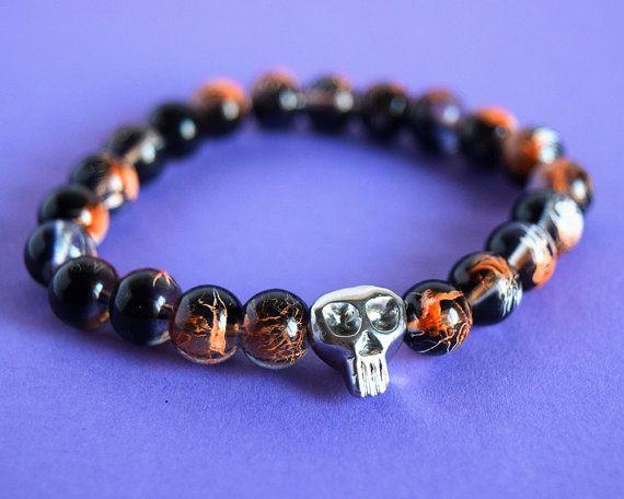 Fire glass beads and metalic skull bracelet