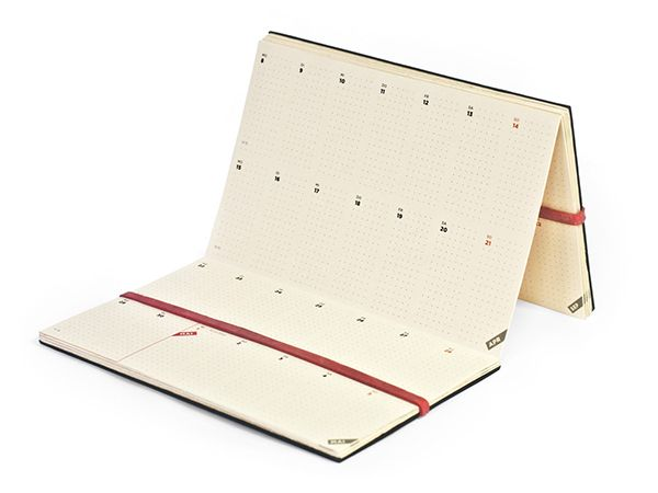 The Dayz planneris made out of one seamless piece of high quality, matte ivory paper, folded into a zig-zag accordion.