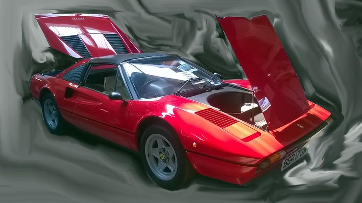 The Ferrari 308 GTS is pictured at a car auction in East Anglia.