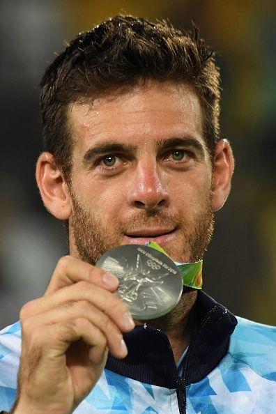 Silver medallist Argentina's Juan Martin Del Potro poses on the podium of the…