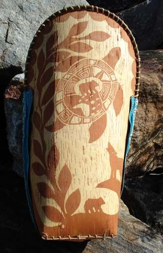 Birch bark baby carrier, elaborately etched.