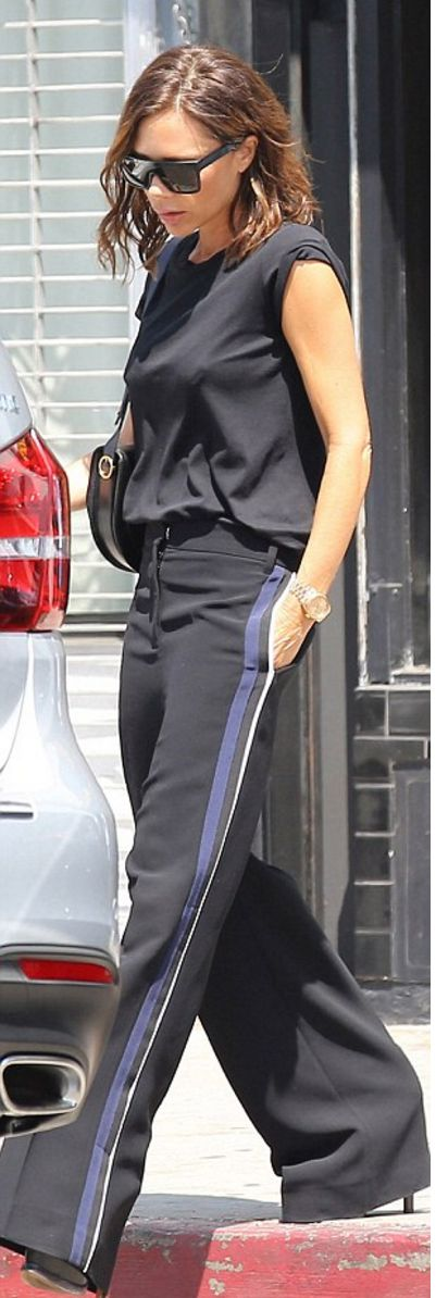 Who made Victoria Beckham's black pants, sunglasses, and handbag?
