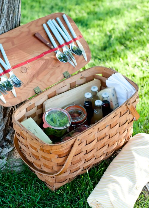 12 Secrets to the Perfect Picnic     A picnic basket doesn't always have to be a basket. Baskets are fun, coolers are practical, and plastic grocery sacks are inexpensive. What will suit the needs of your picnic best? Wooden crates are great for lugging around a heavy load. Or a stylish beach bag might be just the thing. My preferred carrier is a good, old fashioned wooden picnic basket.