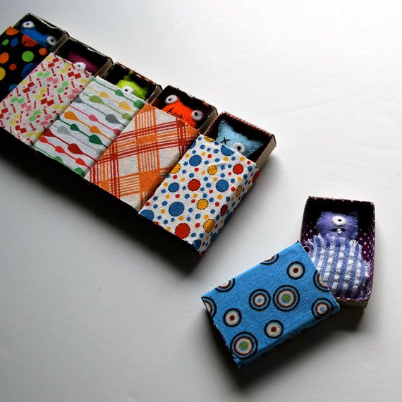 felt monsters with their own beds....thinking little felt vampires in altoid tin coffins would fun, too!