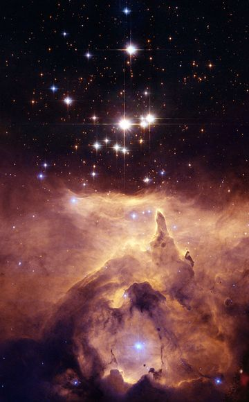 Images from Hubble Space Telescope. Star cluster Pismis 24 hangs over the dusty clouds of NGC 6357, a nebula about 8000 light-years away in the constellation Scorpius. This picture showed that the brightest star in the cluster is in fact two stars in a tight binary orbit. Each star is about a hundred times the Sun's mass.