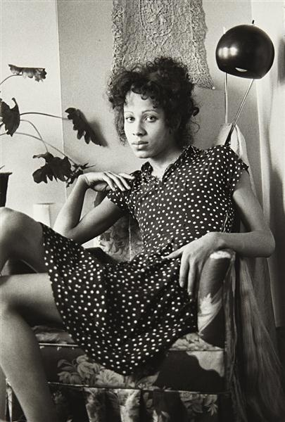 NAN GOLDIN  Roommate in her Chair, Boston, 1972.