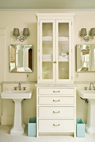 tall skinny cabinet in between vanities  misty