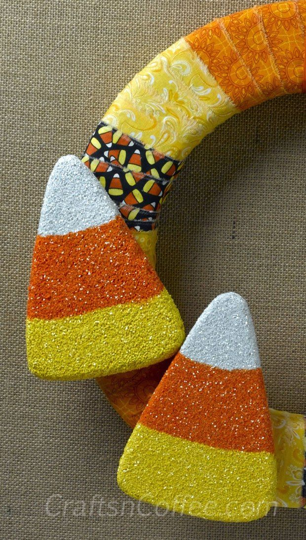 Glittering Candy Corn Wreath. Sweet! And there are so many other ways to decorate with these glittered candy corn, too. CraftsnCoffee.com. #NonScaryHalloween
