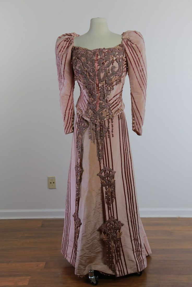Dress is fashioned of pink silk faille with mauve velvet striping. Dress has incredible beaded appliqués, embroidered appliqués and hanging beads, and beaded fringe. On the front, on the back and on the skirt. | eBay!