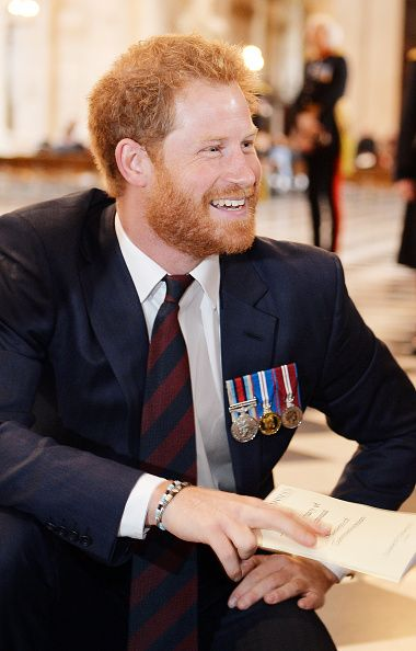 Prince Harry kneels down to talk to two Sappers who both lost their legs in Afghanistan in 2010 following a service marking the 75th anniversary of Explosive Ordnance Disposal (EOD) across the British Armed Forces at St Paul's Cathedral on October 22, 2015 in London, United Kingdom.