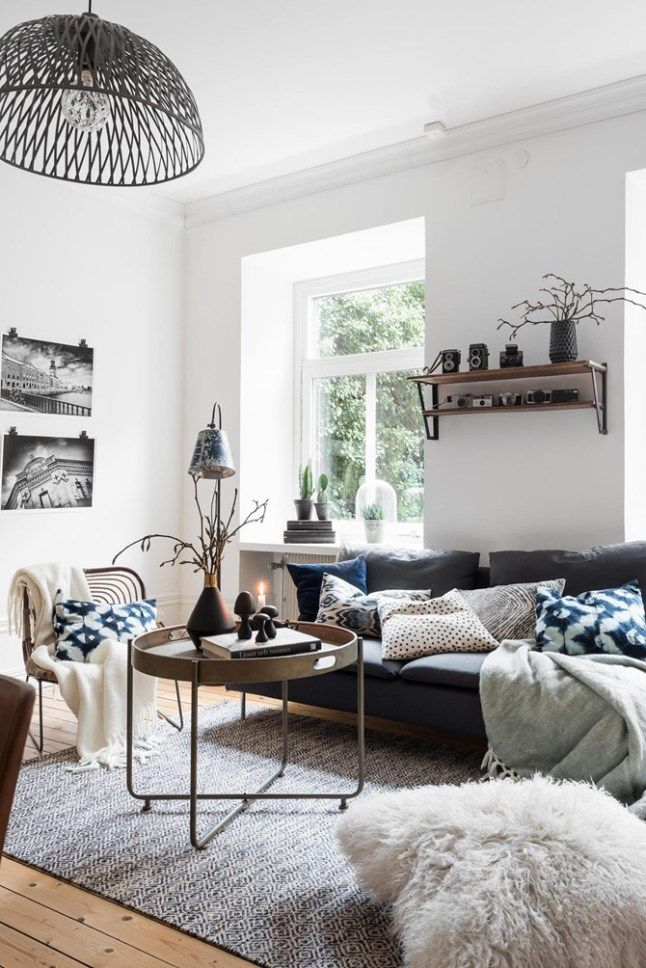 textures add beautiful depth this this living room. Sheepskin pillows