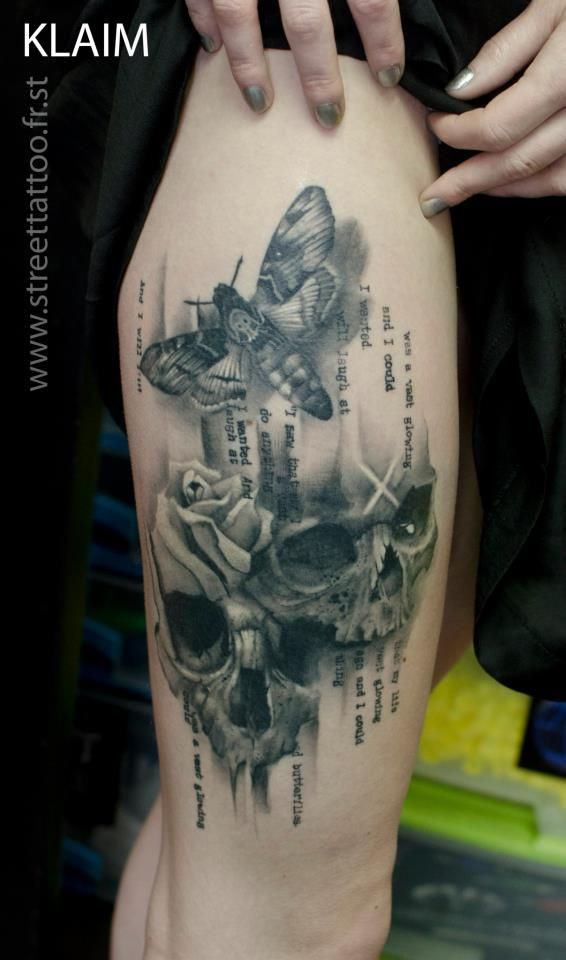 Klaim. Street Tattoo. Francomville. France. Interesting combination of skulls and a moth. Combined with the writing it looks like something out of an anatomy book. I like the darkness of it.