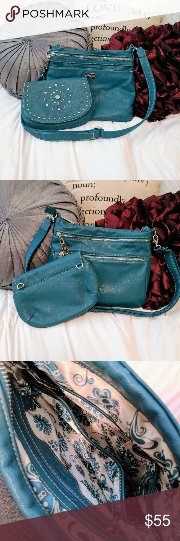 Grace Adele Purse and Wallet/Clutch (PRICE IS NEGOTIABLE) Teal purse and wallet/clutch combo from Grace Adele. Silver zippers and detailing. Very cute. Strap is adjustable. You can move the strap from the purse to the wallet/clutch. Soooo many pockets! Only minor thing is shown in the last photo. Other than that, everything is clean with no stains. Color best matches first and second photo. 100% polyurethane - exterior 100% polyester - inside Bags Crossbody Bags