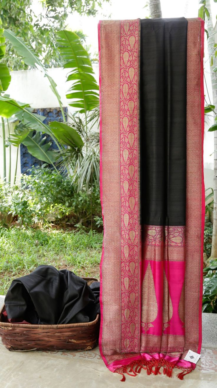 This Benares tussar sari is in black. The contrasting border and pallu are in magenta and gold zari along with little emerald thread work making this sari light and beautiful to wear in this season