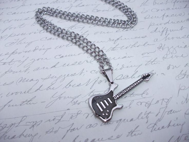 Stainless steel guitar necklace de la boutique BijouxdeBrigitte sur Etsy
