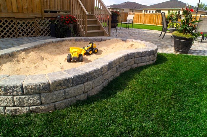 Brick retaining wall sandbox. Way prettier than a wooden one, and when the kids outgrow it, just plant some pretty flowers inside!!