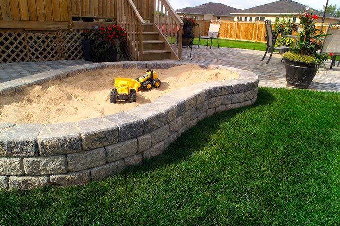 Brick retaining wall sandbox