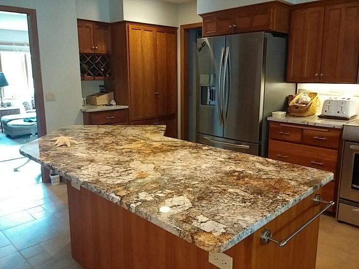 This Granite Island Really Enhances The Richness Of The Kitchen Cabinetry |  Midwest Stone Source |