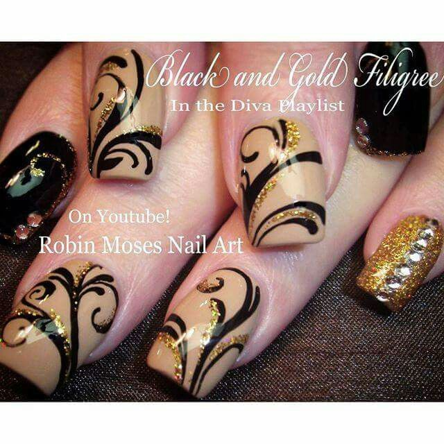 Black and gold filigree nail art by Robin Moses