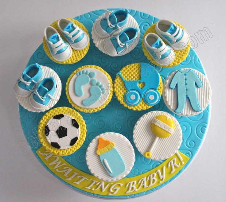 Cupcake inspiration baby shower rattle booties for Baby footprints cake decoration