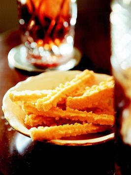 Trisha Yearwood's Cheese Straws Ingredients: 3 (10-ounce) bricks sharp cheddar cheese, room temperature 1 cup (2 sticks) butter, softened 4 cups sifted all-purpose flour 2 tsp. salt 1/8 tsp. black pepper 1/8 tsp. cayenne pepper Dash of garlic powder