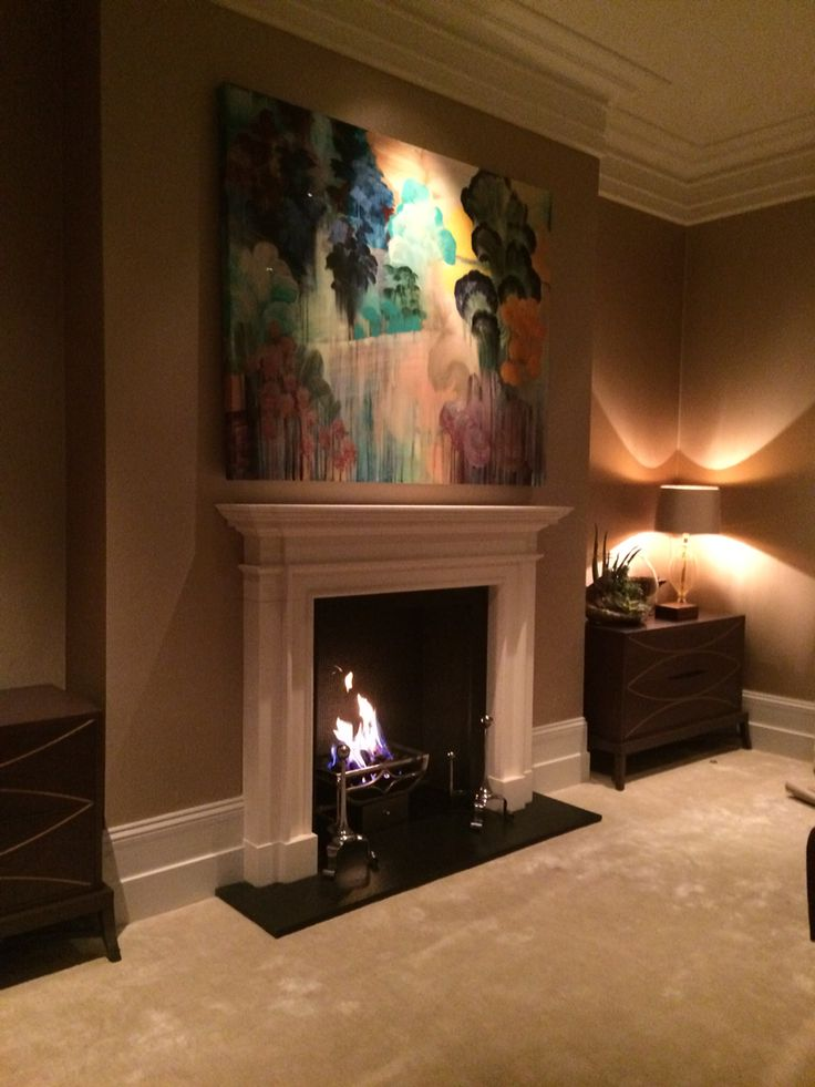Chesneys limestone surround with gas fire and slate hearth and slips.