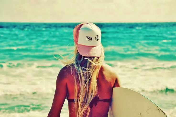 Girl with cap goes surfing