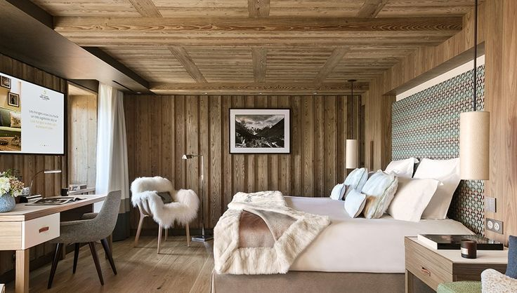 Hôtel Barrière Les Neiges opened last December in France's infamous alpine ski-in/ski-out resort Courchevel 1850. Designer Nathalie Ryan combined warm earth tones, larch wood walls and ceilings, and comfortable materials like cashmere, velvet, and fur for a warm and cozy interior that almost makes you want to forgo the world's largest ski area and curl up inside. Snuggle in with a fluffy wool blanket and a warm beverage to enjoy a movie in the private cinema room, or bundle up with a p…
