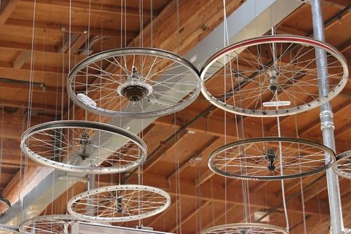 Bicycle wheels as ceiling decorBikes Decor, Bikes Tires, Features Wall, Food, Bicycles Wheels, Ceilingdecor Weddingideas, Add Lights, Ceilings Decor, Home Decor Bicycles Bike