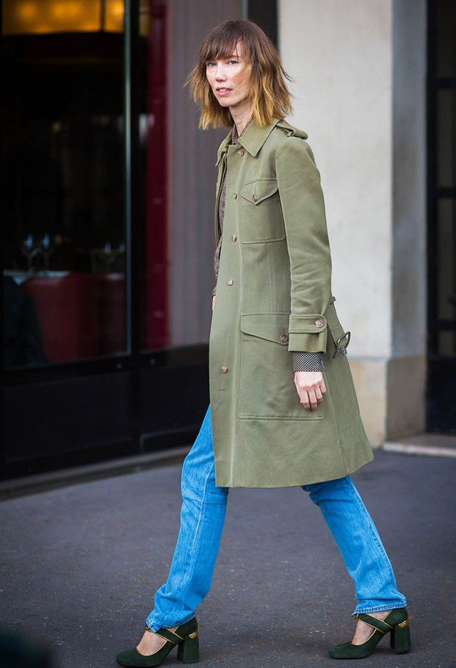 Anya Ziourova in jeans, a military-style jacket, and Mary Janes.