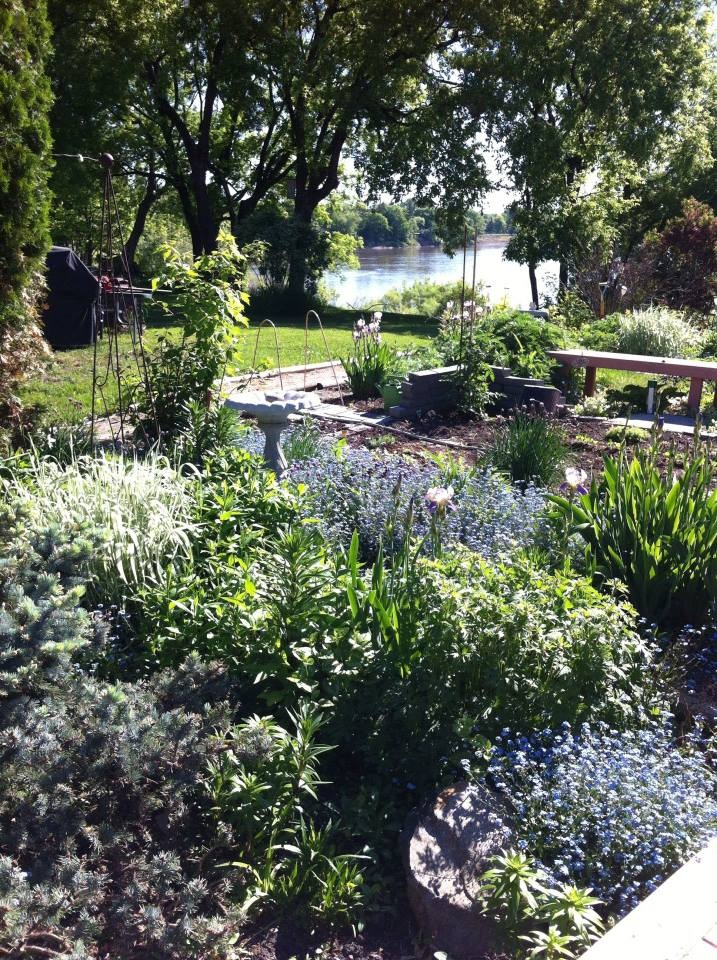 The sunny side of the Upper Gardens + Veggie Garden with river below