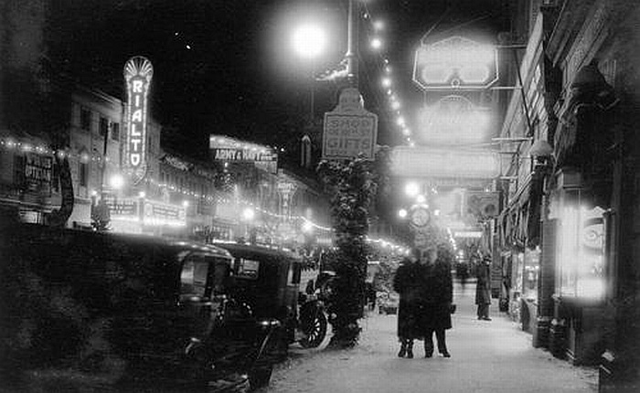 Neon signs on 101 St in December 1933.