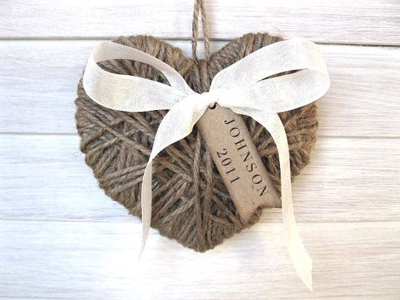Buy a craft store shaped wood heart and some twine and glue and wrap. Add ribbon for the bow and cut out card stock with writing.
