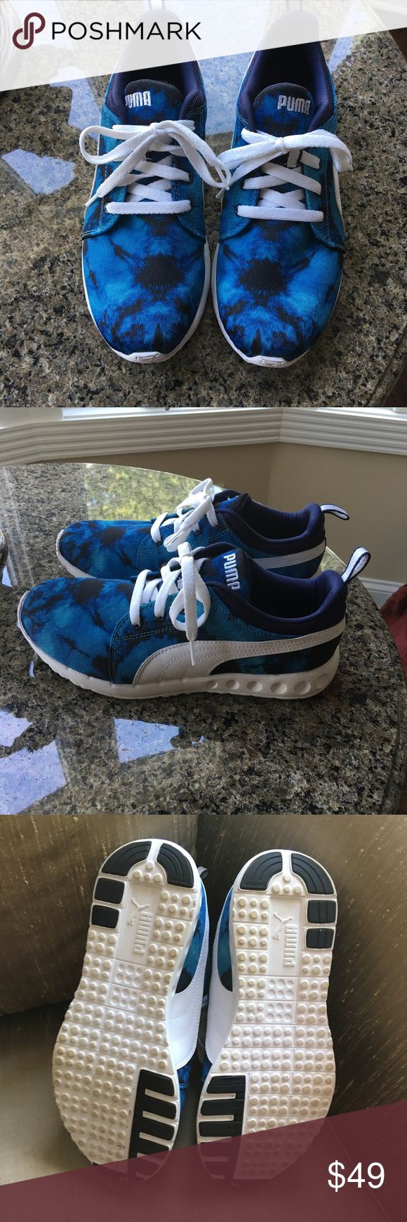 Women's black and blue puma sneaker Brand new worn once . Women's puma sneakers Puma Shoes Athletic Shoes