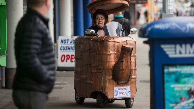 mobility scooter disguised as giant copper teapot, by steampunk store owner Katrina Douglas and partner Neave Willoughby, Christchurch, New Zealand