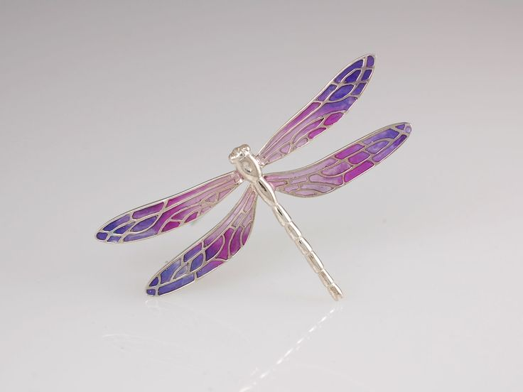 Dragonfly Brooch. $289 Silver. Simply beautiful sterling silver dragonfly brooch created in our our Nelson workshop. The wings are coloured with UV acrylic resin and each one is slightly different due to the unique colour blending process. Available in green, blue or purple. Or maybe you have a colour scheme you would like to request? We're happy to help! The dragonfly wingspan is 6 cm wide. Jewellery made @Jewel Beetle in Nelson, New Zealand.