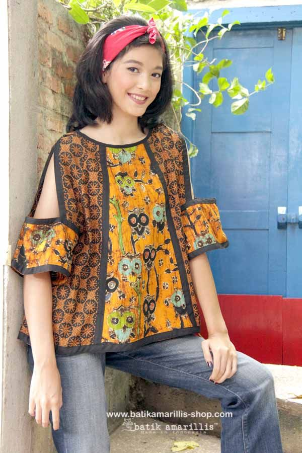 Batik Amarillis made in Indonesia www.batikamarillis-shop.com - Batik Amarillis's Breezy no 4 -it's gorgeous top with unique hanging cut out sleeves, pair it with your fave's jeans and you're ready for some actions!