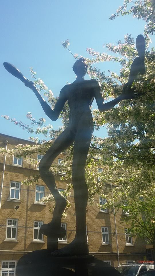 The Juggler in Hoxton Market.  A skinny, unsmiling figure in his underwear, apparently to commemorate the traditions of theatre and music hall in Hoxton and Shoreditch.