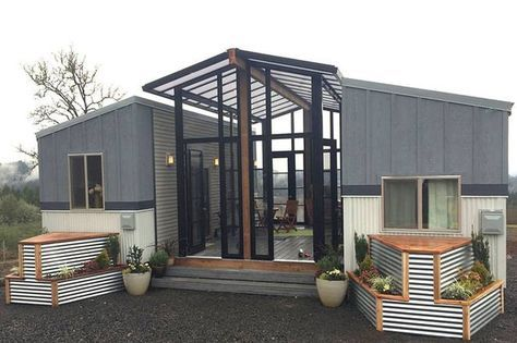 Two tiny houses and open-air sunroom in one family home