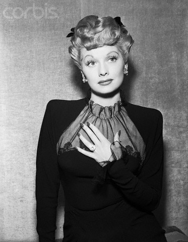 Lucille Ball, star of I Love Lucy, wearing the large cushion-cut diamond engagement ring given to her by co-star and husband Desi Arnaz. Beautiful, isn't it?