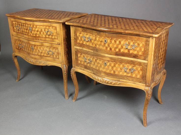 """Lot 911, A handsome pair of 20th Century marquetry commodes of serpentine outline, the crossbanded tops inlaid geometric panels, fitted 2 short drawers, raised on cabriole supports 302h x 31""""w x 19""""d, sold for £400"""
