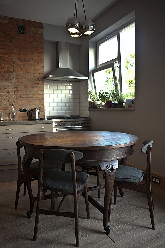 Eat In Kitchen With Vintage Table Exposed Brick Walls Contemporary Cabinets Tile Lighting